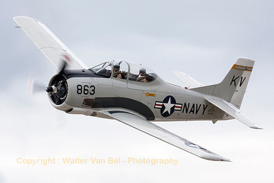 It's always nice to watch a fly-by of a warbird (even with poor weather conditions). This T-28B Trojan (NX377WW / 137777/KV-863; cn 200-140) banks nicely to show its beautiful shapes to the photographers, during the spottersday at KB, prior to the Sanicole Airshow 2013.