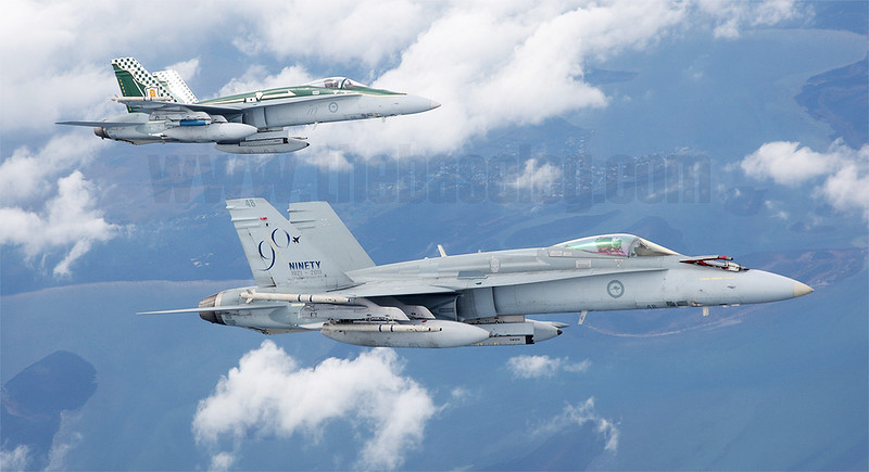 Royal Australian Air Force F/A-18A Hornet A21-48 and A21-49, both in special commemorativel schemes, formate on an Airbus KC-30 tanker off Gippsland in Victoria
