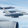 A pair of Republic of Singapore Air Force Lockheed-Martin F-16C Fighting Falcons and a Boeing F-15SG Eagle formate on a KC-135R tanker