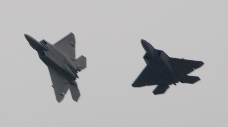 A pair of F-22 Raptors make a thundering arrival. They flew for about 10 minutes.