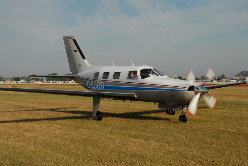 A German Piper Malibu heads home, one of two planes which I saw which flew to Oshkosh from Germany.