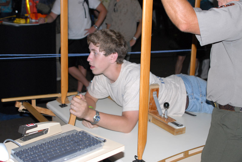 Kevin, trying to fly the Wright Flyer simulator in the National Park Service's booth.