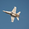 US Navy F/A-18 Hornet in knife edge flight at AirVenture - 28 July 2012