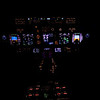 Night view of a 737 NG flight deck at cruise altitude 'flight level 380' or 38,000 feet.  Boeing 737 NG or Next Generation CRT 'Glass Cockpit' instrumentation.