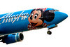 Sometimes airlines use their aircraft as flying billboards to promote vacation destinations.  This Alaska Airlines Boeing 737, on approach to Anchorage Int'l (ANC), sports a Disney theme featuring Minnie Mouse.  June, 2005