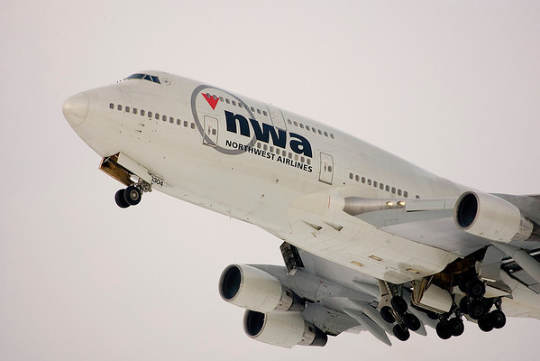 Northwest Airlines Boeing 747-400 (Flight #3, non-stop MSP to Tokyo) departing Runway 22 at MSP.  Soon these aircraft will be repainted in Delta Airlines colors.  13 Dec 2008