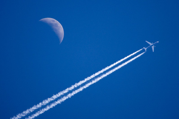 An airliner (I think a Boeing 777) passes by the moon over Washington DC. March 12, 2008