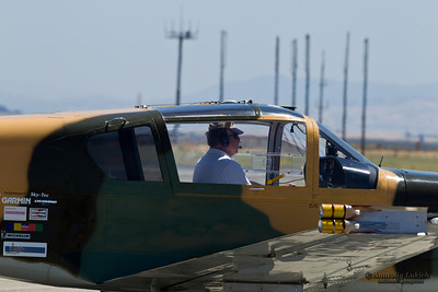 TRAVIS AIR FORCE BASE, CA - JULY 30: Professional Airshow Pilot and Announcer Steve Stavrakakis taxi  on his IAR-823 after landing during Airshow  on July 30, 2011 at  Travis Air Force Base, CA.