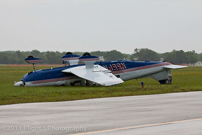 This Piper Saratoga was tossed about with tiedown ropes still attached.