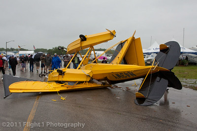 An Aviat Husky on floats was tossed in the middle of a pedestrian walkway at the 2011 Sun 'n Fun airshow.