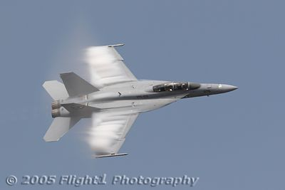 A Super Hornet pulss some vapor during the Air Power Demo