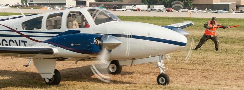 Civil Air Patrol (CAP) Cadet William Santos puts his heart into marshaling aircraft at Oshkosh (#2).