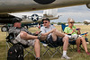CAF Minnesota Wing members Scott Belbeck, Kurt Koukkari, and Linda Franke relax at the end of Airventure's first day.