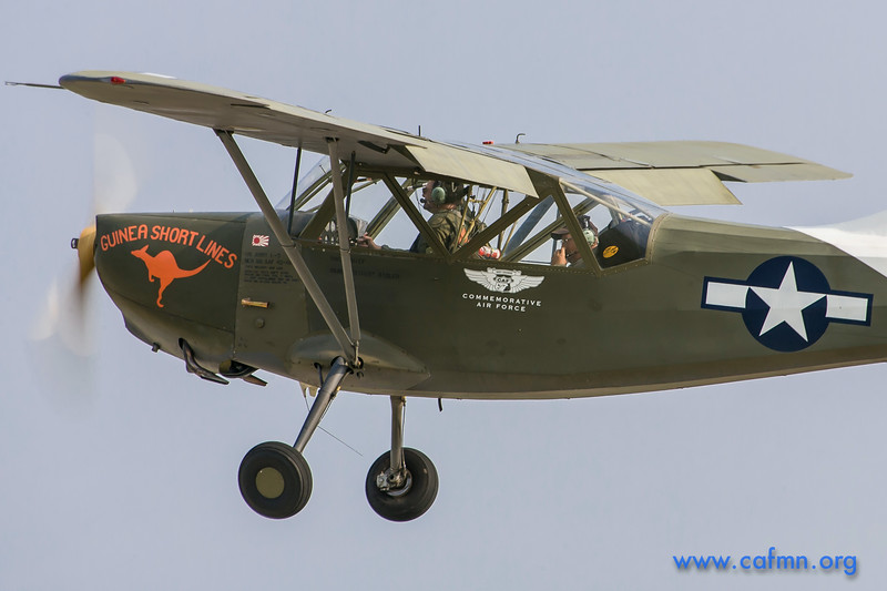 The CAF Minnesota Wing's L-5 airborne, with pilot John Schmidt at the controls and member Bob Koelbl in back seat.
