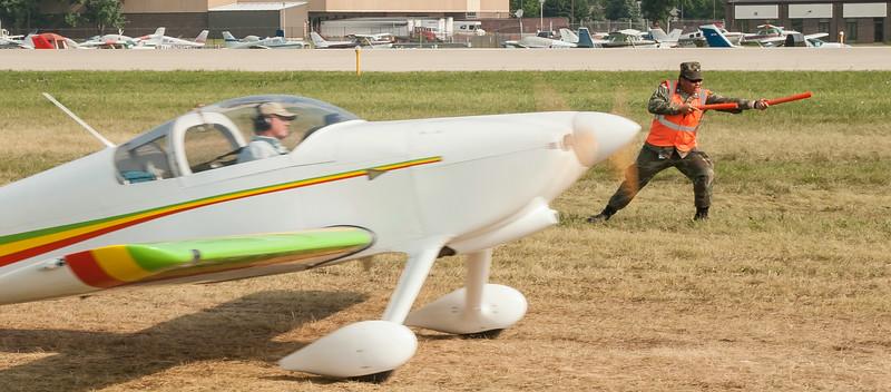 Civil Air Patrol (CAP) Cadet William Santos puts his heart into marshaling aircraft at Oshkosh (#4).