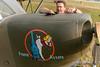 CAF pilot John Schmidt performs preflight checks on the Minnesota Wing's L-5 Sentinel.
