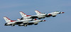 USAF Thunderbirds F-16 aircraft take off in formation.