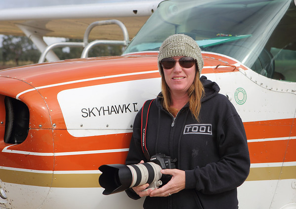 The other author and flight director Sarah Lovelock ,on a cold day for a previous flight in the Cessna 172  at Young Airport.