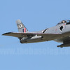 Sunlight reflects off the starboard leading edge as Temora Aviation Museum's CAC Sabre VH-IPN goes through its display.