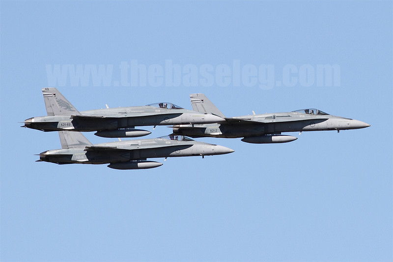A trio of RAAF F/A-18As fly in close formation as part of their handling display. Note No. 2 and 3 keeping a close eye on their leader.
