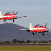 With the You Yangs providing a nice backdrop, No.2 Flying Training School Pilatus PC-9As A23-013 and A23-054 take off as part of a 3-ship formation
