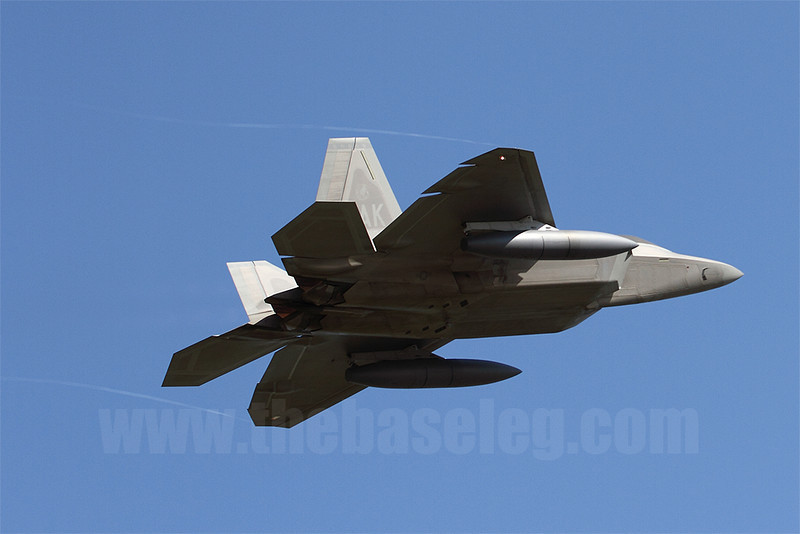 Unfortunately the F-22s at Avalon did not participate in the flying program; the only way to get them in the air in good weather was on their departure the Monday after the show. Here AK/06-0108 streams vortices as she pulls Gs on the verge of initiating a sharp climbout on departure