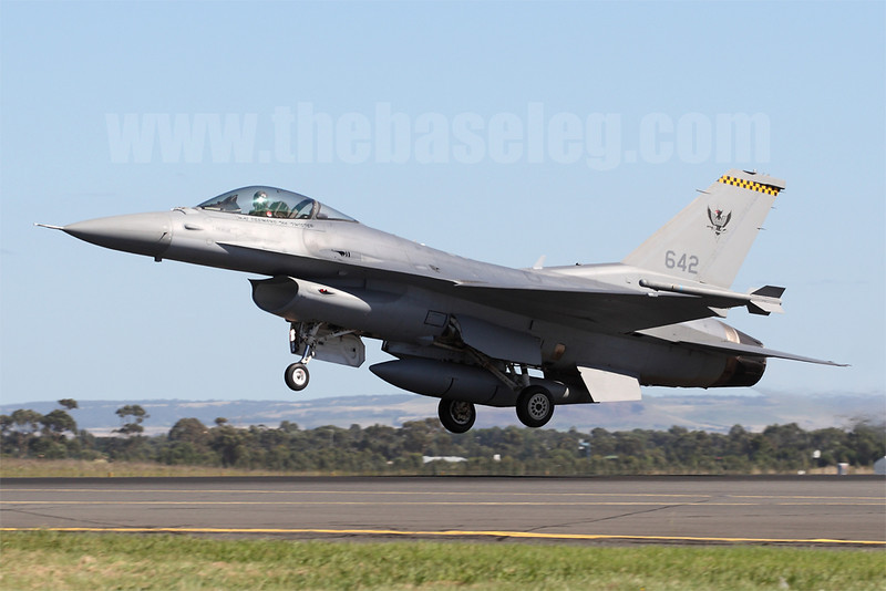 Republic of Singapore Air Force F-16C 642/97-0117 blasts off the runway to begin its display.