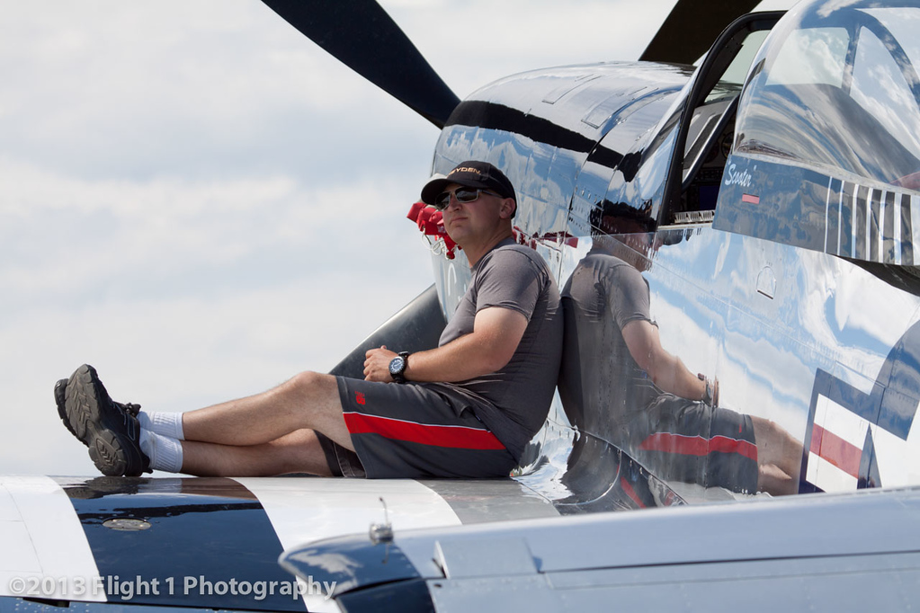 """Scott """"Scooter"""" Yoak on the wing of his P-51 Mustang """"Quick Silver"""""""