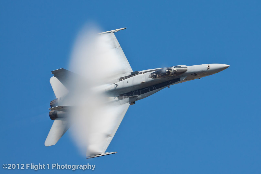 An F/A-18 Hornet high-speed pass. The vapor cone is created in humid air just below the transonic speed range.