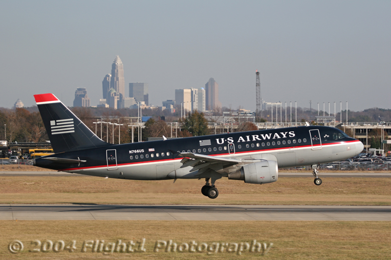 N766US, a US AIrways Airbus A319 Landing with the Charlotte Skyline as a Backdrop