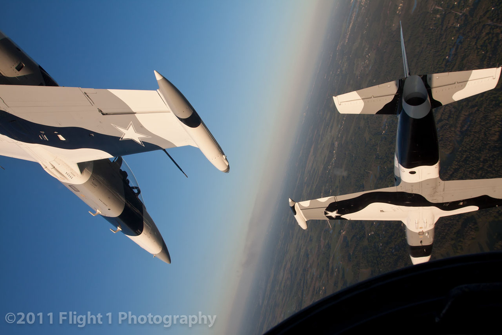 A diamond formation barrel roll with the Black Diamond Jet Team.