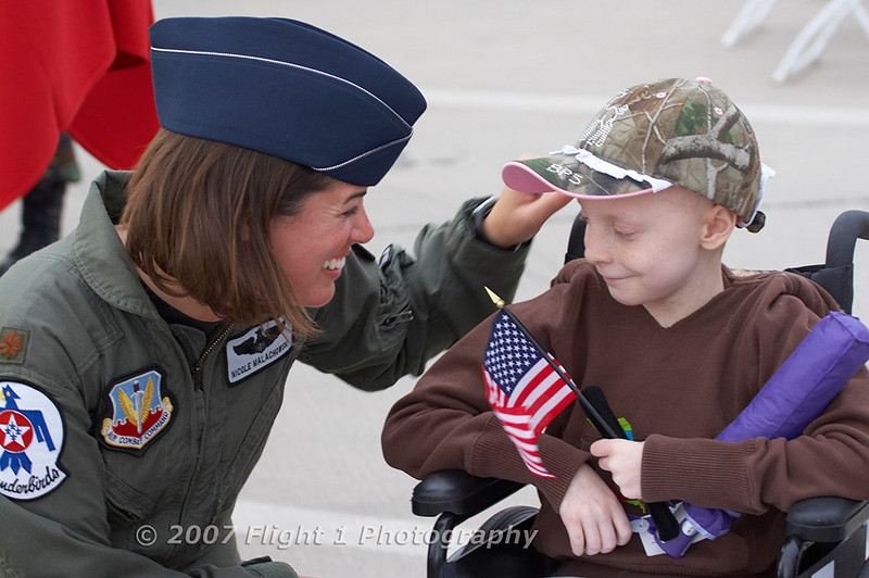 The first female Thunderbird pilot, Maj Nicole Malachowski greets a young fan.