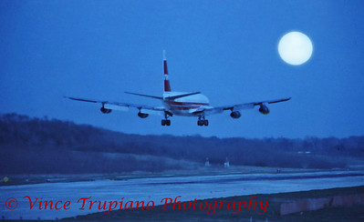 Moonlit landing on runway 10L at Pittsburgh International Airport.