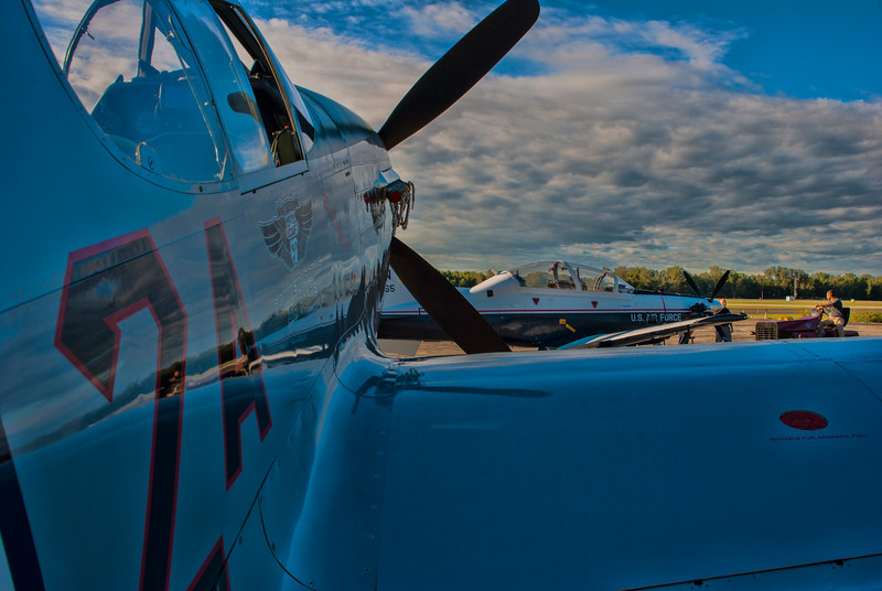 The Mustang and a visiting T-6 Texan II trainer