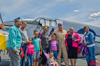 An extended family visits with Bill Shepard at the Mustang.