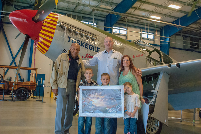 Dr. Brown with a family who came to give him a print and to have one signed.