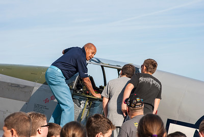 Dr. Harold Brown showing the Mustang cockpit to students at the Liberty Aviation Museum in Port Clinton Ohio.
