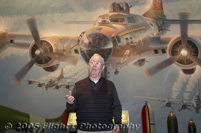 "Aviation Artist Keith Ferris in front of his mural of the B-17 ""Thunderbird"""