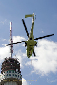 Helog's Super Puma is on its way for another flight to dismantle the old analog TV antenna from the KPN broadcast tower at Roermond.