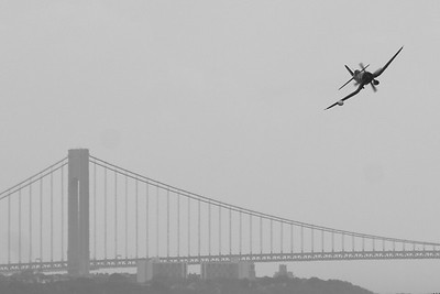 A restored F4U Corsair overflying the upper bay near Liberty State Park, with the Verrazano Bridge in the background.  Photograph taken 6/20/2010.