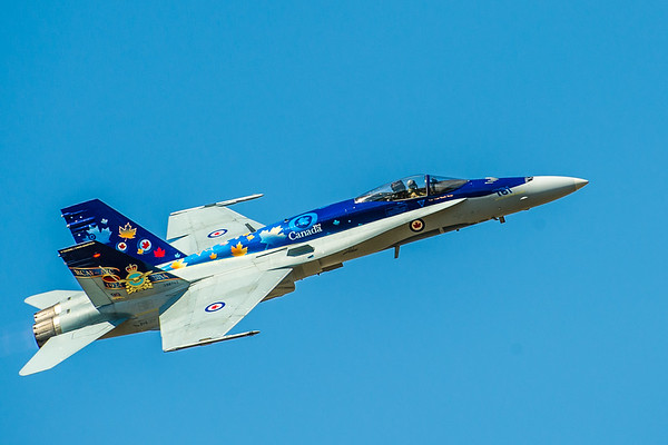 """CF-18 Demo Pilot, Captain Adam """"Manik"""" Runge, performs at the Abbotsford Airshow on Saturday 9th August, 2014, in the """"To the Stars – Fuelled by Legacy"""" themed McDonnell Douglas CF-188 Hornet.  Photo by: Stephen Hindley©"""