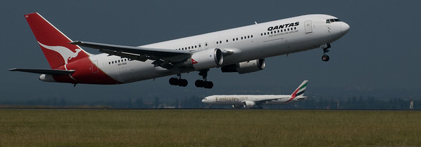 A photo of an airliner run by an efficient management team. And in front, a Qantas Boeing 767.