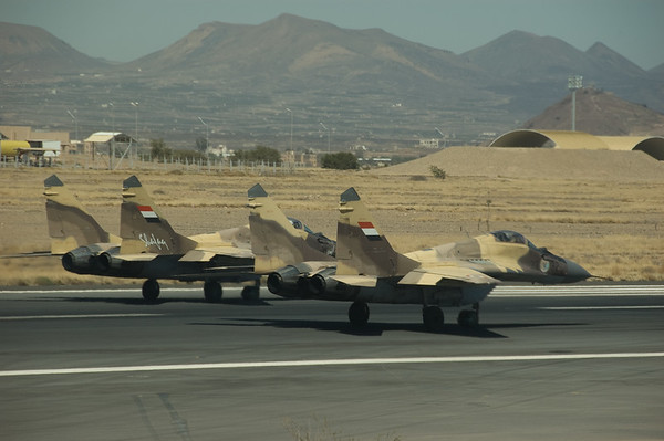 Mikoyan MiG-29's of the Yemeni Air Force ( #22-16 and 22-32) line up for departure from Sana'a, Yemen,  Photo by Stephen Hindley
