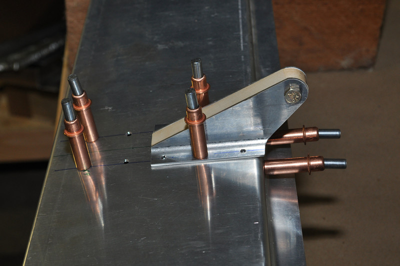 Both TS-16 brackets clecoed to the skin. There are two ribs inside, as well, one underneath each bracket. The rod for adjusting the anti-servo tab attaches to these brackets.