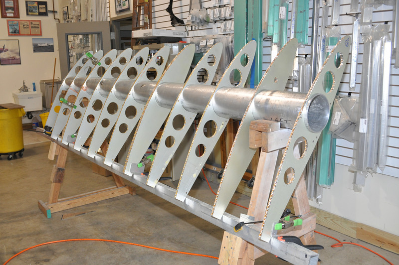 At 4' and 8' from the fuselage, there are doubled ribs. These are the lines where there are seams in the wing skin so these doubled ribs need to be very precisely placed. The others are not so critical. You can see the clamps in this photo.