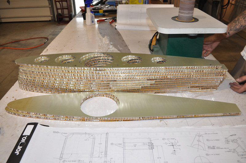 The whole set of ribs for the left wing. Two are mostly solid. The rest have lightening holes in them.