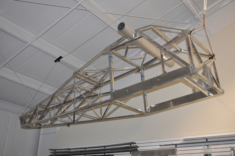"""The fuselage is assembled and already """"flying"""" near the shop ceiling."""