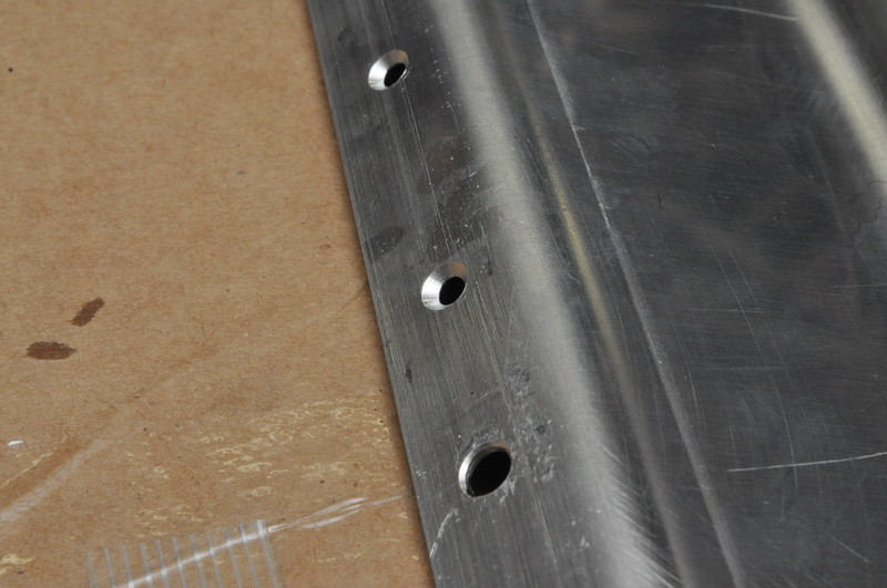 Countersunk holes in a bracket. The dimples in the floor fit into these countersunk holes.