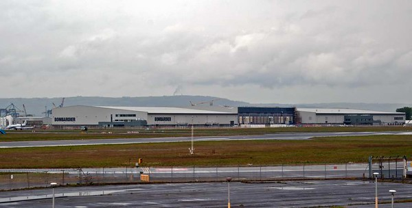 Bombardier Aerospace works, George Best Belfast City Airport, 17 May 2012 1.  Shorts Brothers, then based at Rochester, Kent, opened the plant in 1936.  They moved completely to Belfast in 1948.  Bombardier took over Shorts in 1989, and the plant now makes airframe components.