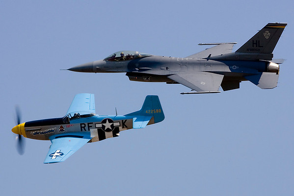 After putting the F-16 through its paces, the Viper paired up with Chuck Hall's P-51 Mustang to perform the Heritage Flight.  Seeing these two aircraft, generations apart in technology, fly side-by-side always thrills me.